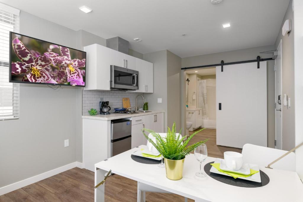 A kitchen or kitchenette at WALK TO GASLAMP SUITE
