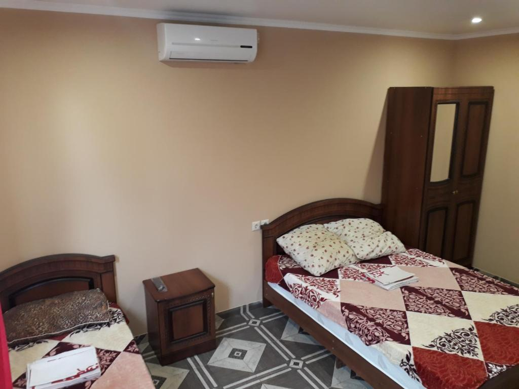 A bed or beds in a room at Guest House Bereg