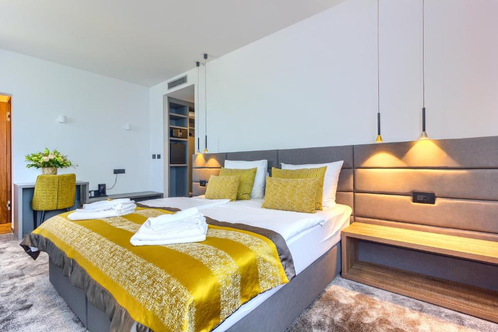 A bed or beds in a room at Bel Residence