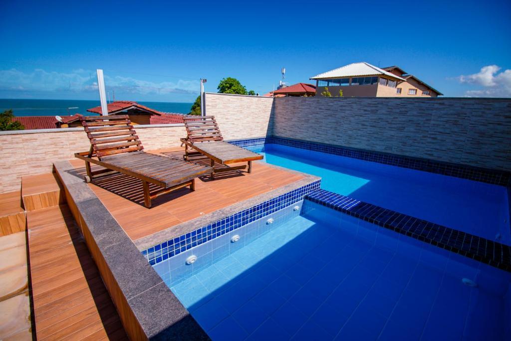 The swimming pool at or near Pousada Pau Brasil Ubu