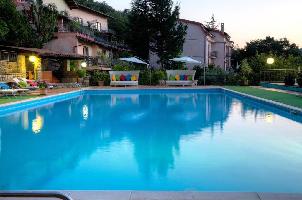 The swimming pool at or near Hotel Sa Muvara