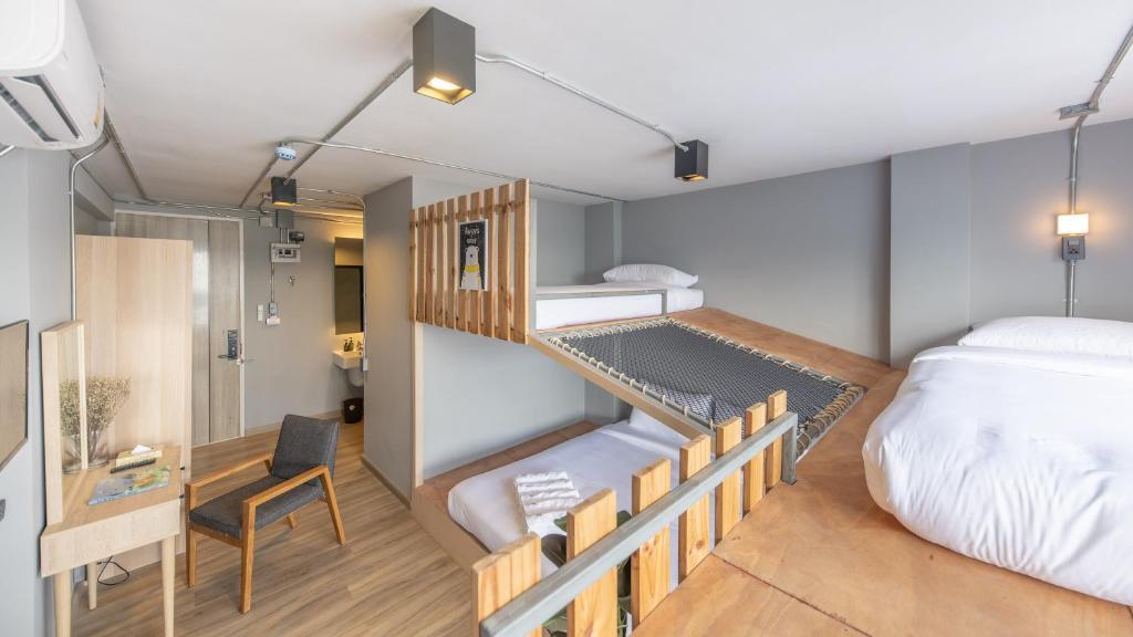 Un ou plusieurs lits superposés dans un hébergement de l'établissement Arch39 Minimal Art & Craft