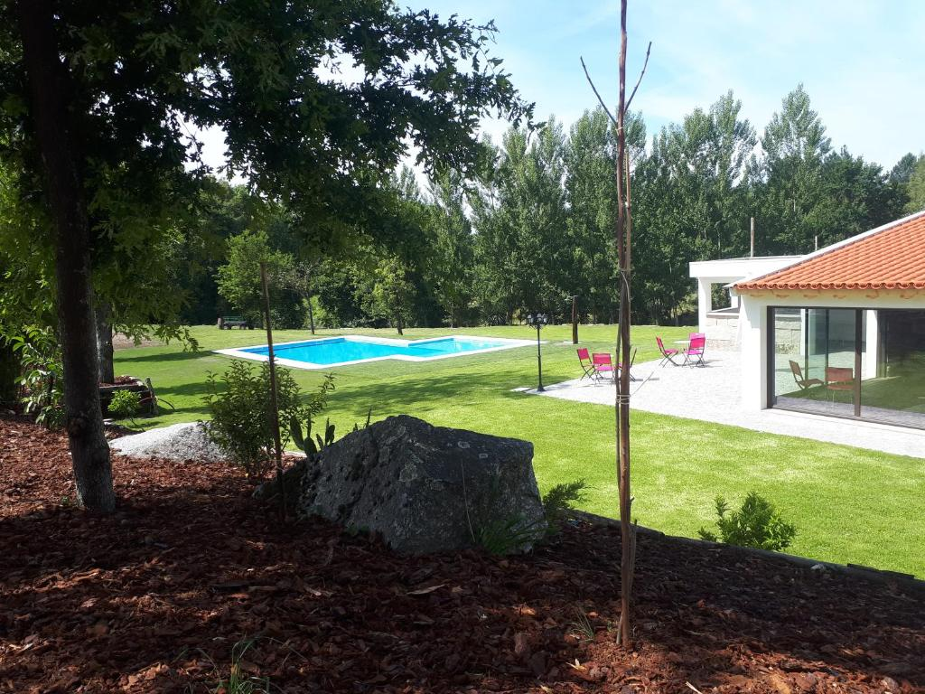 The swimming pool at or near Quinta Do Rio