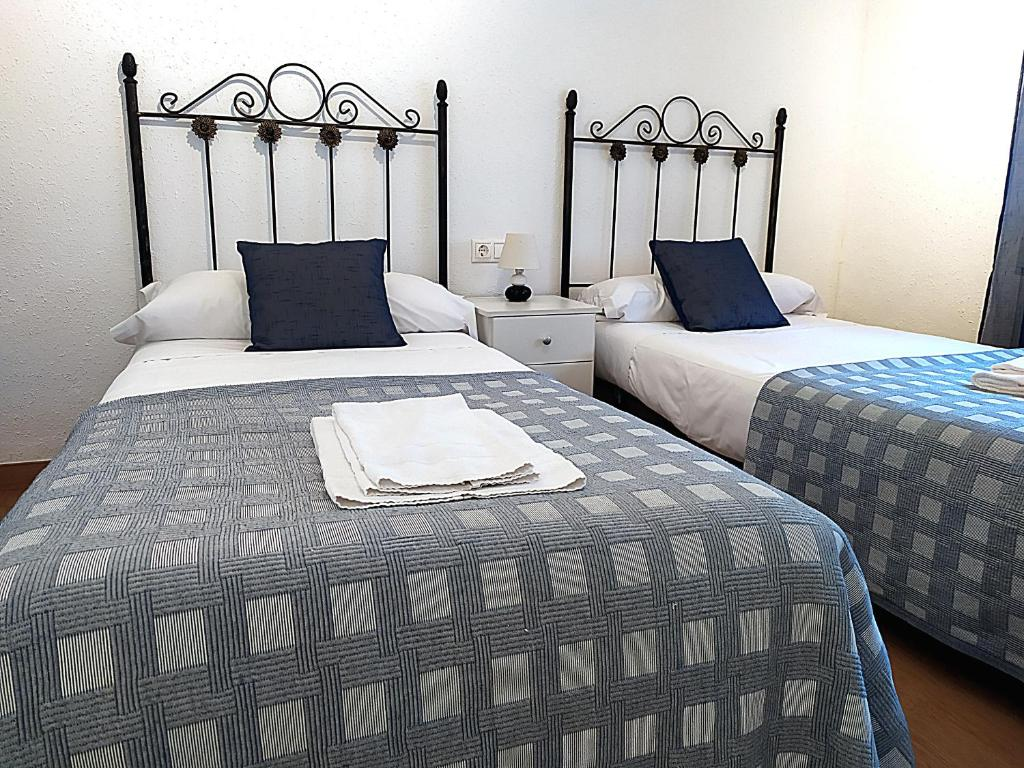 A bed or beds in a room at Comfortable Apartment close to Park Güell