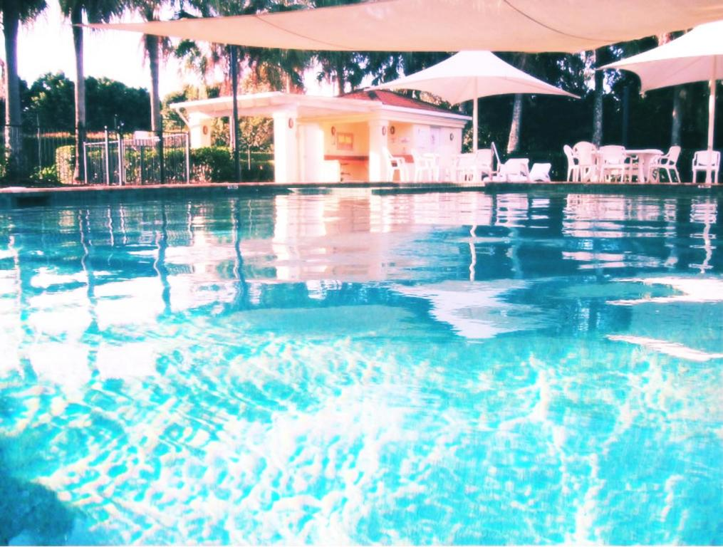 The swimming pool at or near Waterfront Resort Villa with Buggy
