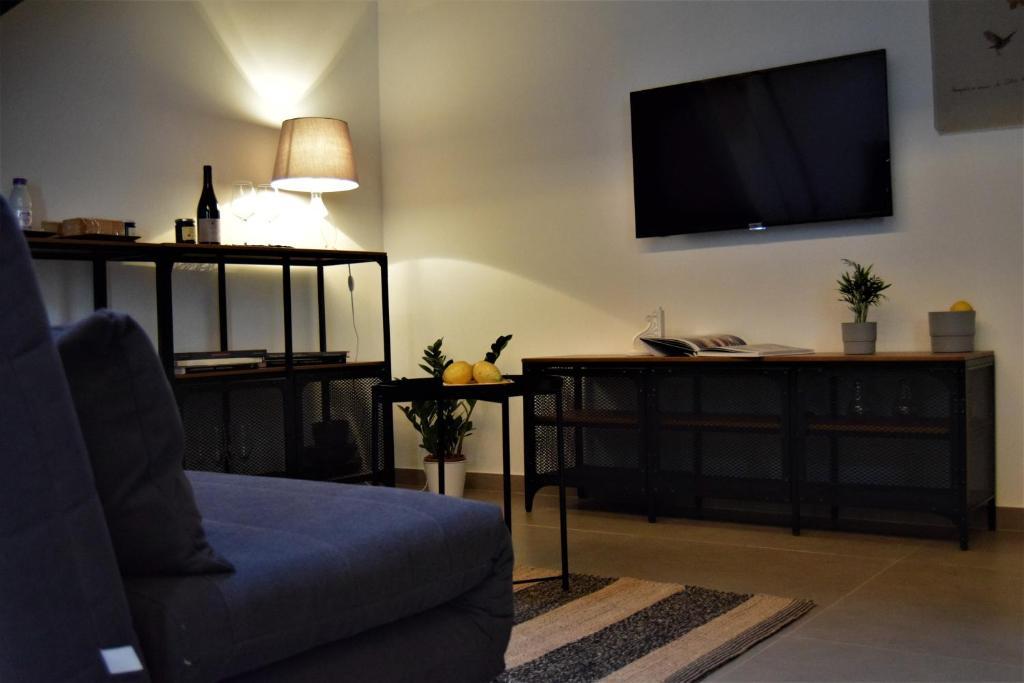 TV o dispositivi per l'intrattenimento presso Il Limone Holiday Home Siracusa