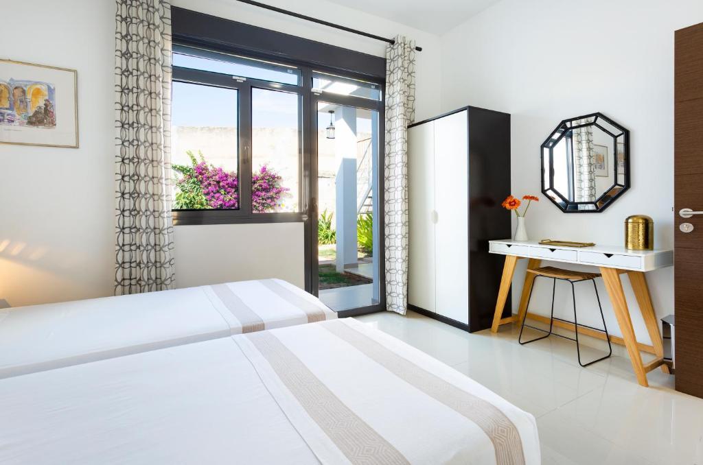 A bed or beds in a room at Casa en Son Espanyolet