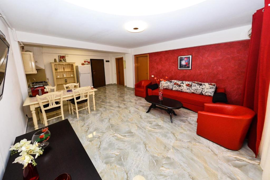 A seating area at Apartament Red Mirage