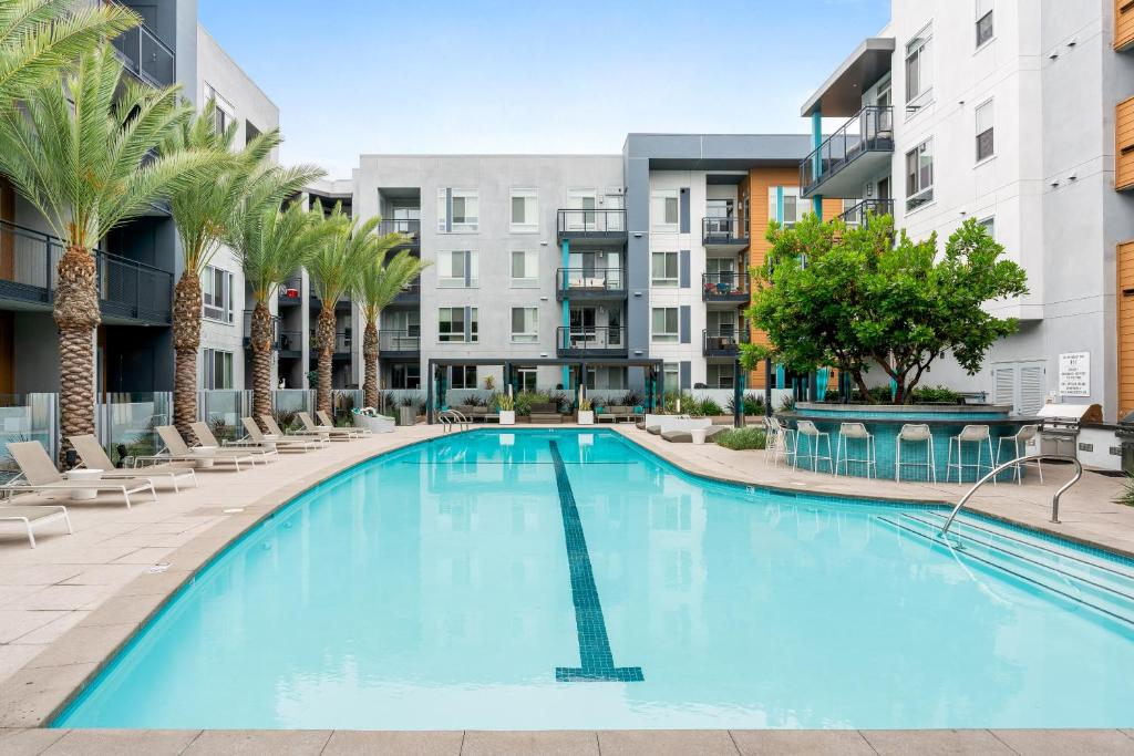 The swimming pool at or near Close to Disneyland + Parking 2 Bedroom Suite
