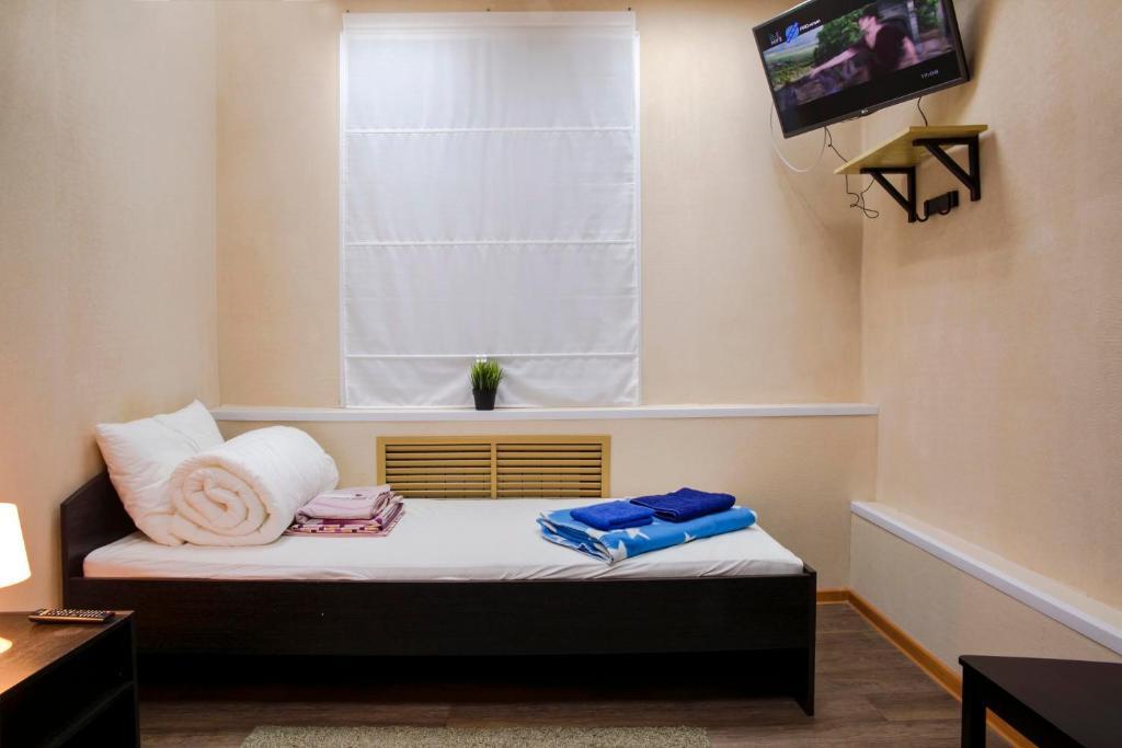 Кровать или кровати в номере Hostel Agat
