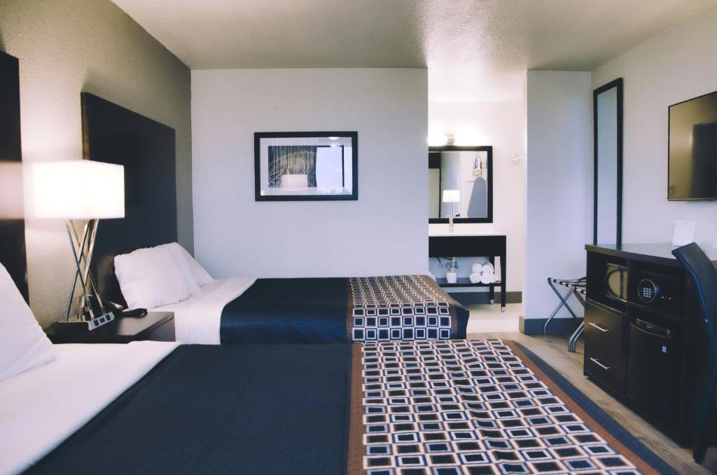 A bed or beds in a room at SonoHotel International Drive Orlando by Monreale