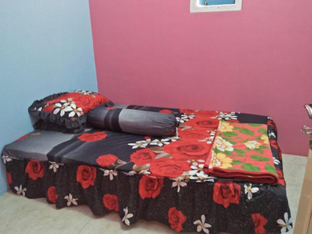 Tempat tidur dalam kamar di Kawah Ijen Inn
