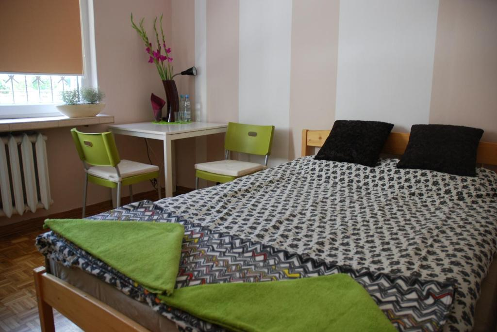 A bed or beds in a room at Lama Rooms