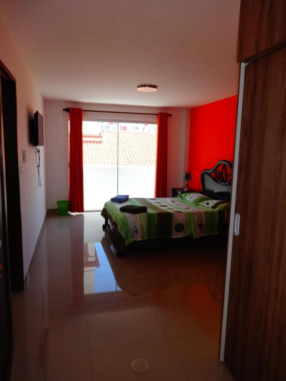 A bed or beds in a room at Backpacker Suites
