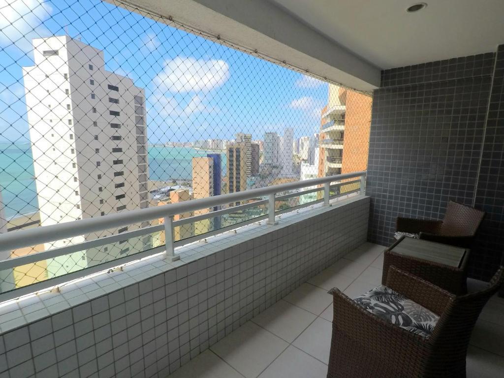 A balcony or terrace at Beach Class By Frente Mar
