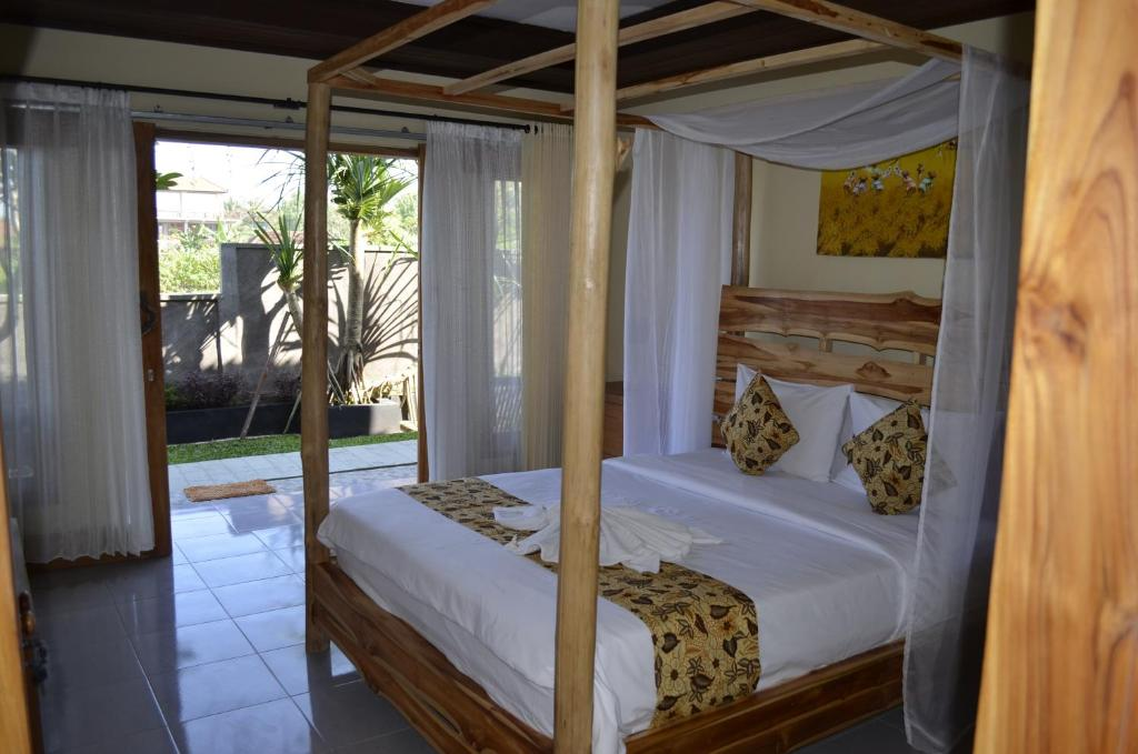 A bed or beds in a room at West Break Bali - Medewi