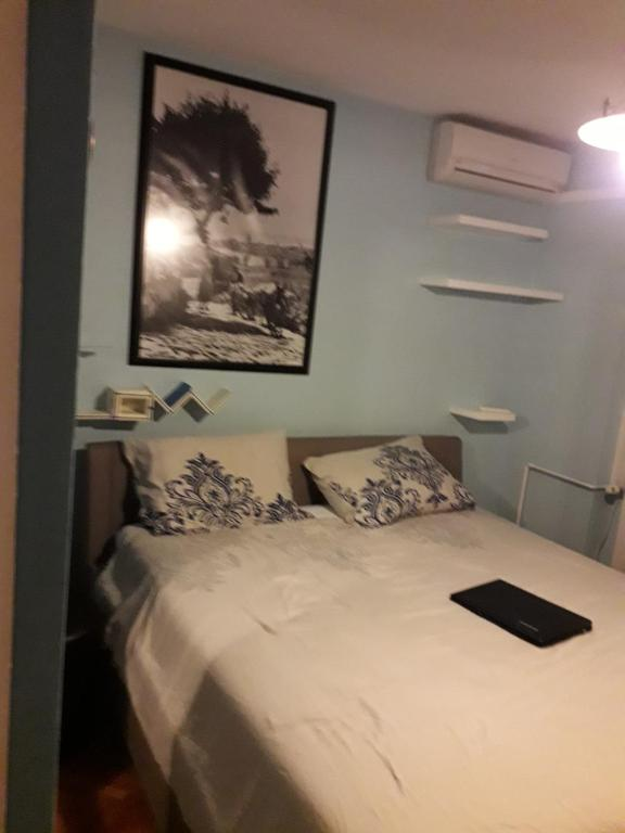 A bed or beds in a room at Rab-centar