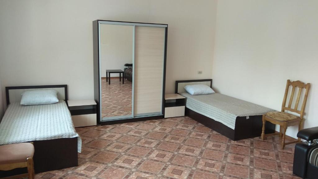 A bed or beds in a room at House on Borgustanskaya 12