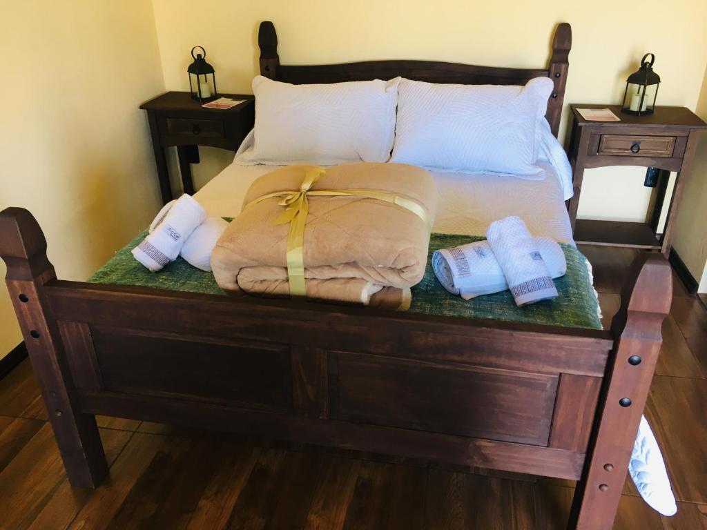 """Cama o camas de una habitación en Hospedaje """" El Segoviano """""""
