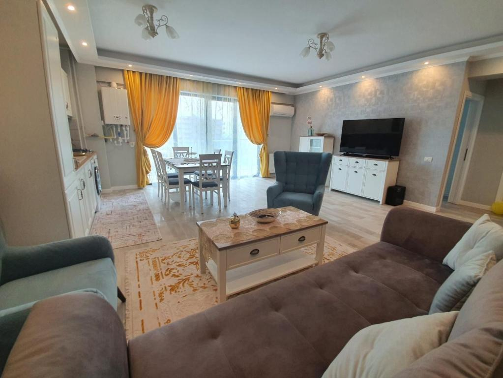 A seating area at Evya Luxury Apartment
