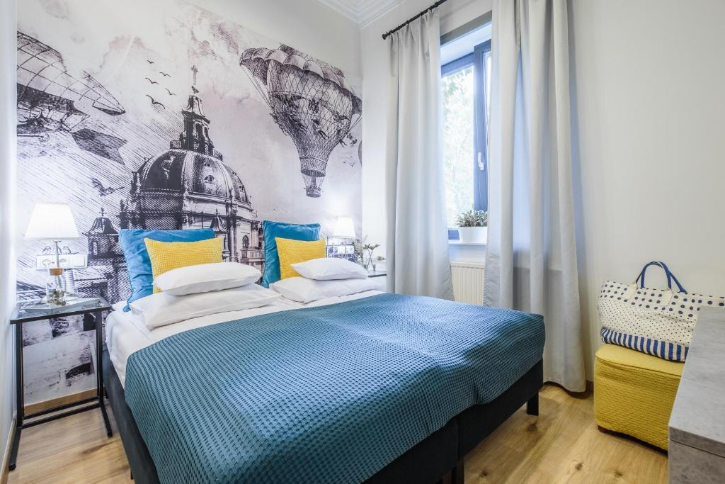 A bed or beds in a room at Fifteen Boutique Rooms Budapest
