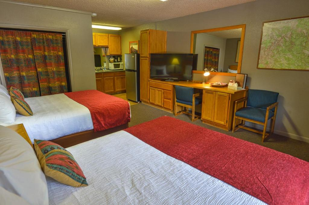 A bed or beds in a room at Rustic Inn