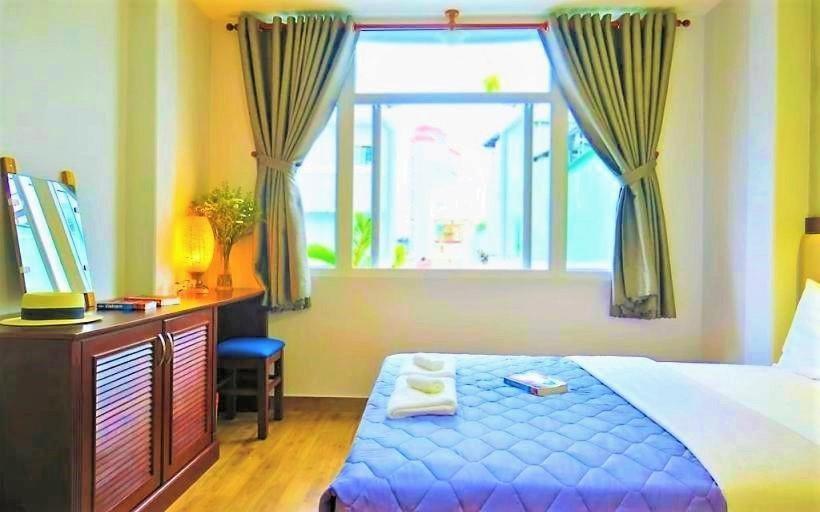 Cama ou camas em um quarto em Giang Son Hotel