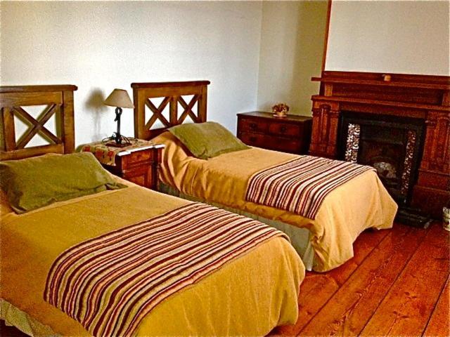 Una cama o camas en una habitación de Estancia Monte Dinero