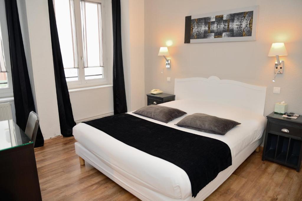מיטה או מיטות בחדר ב-EtC...Hôtel
