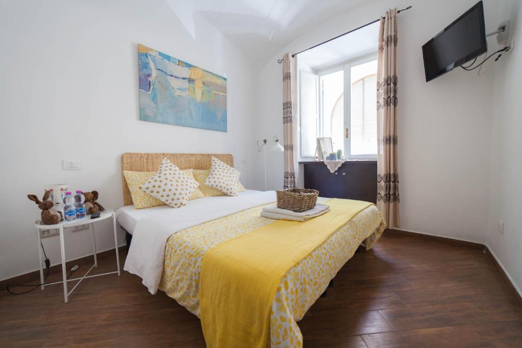 A bed or beds in a room at Romangelo II Hostel