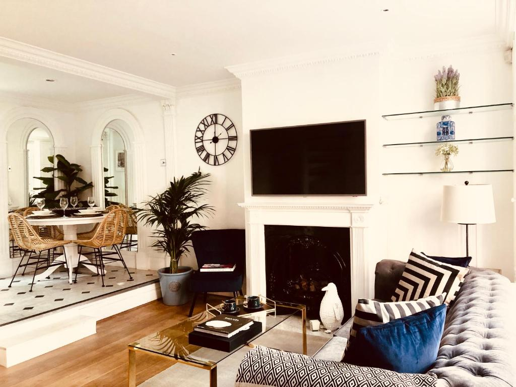 A television and/or entertainment center at Luxury Kensington Town house