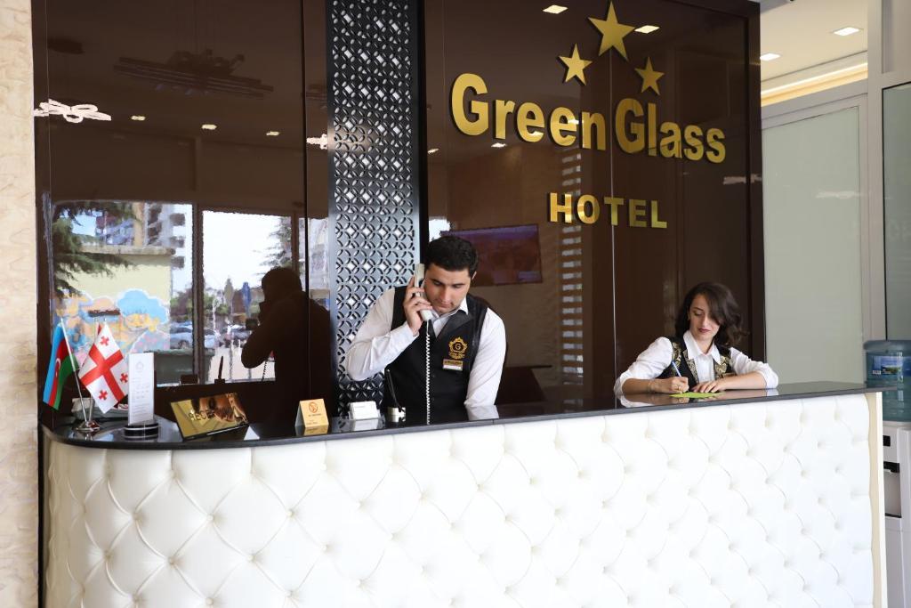 Лобби или стойка регистрации в Hotel Green Glass