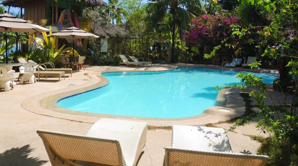 The swimming pool at or near Coral Cay Resort, Inc.