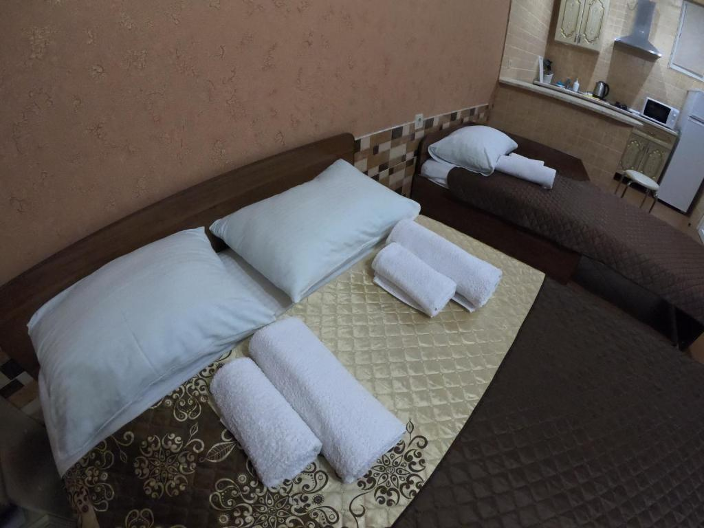 A bed or beds in a room at Guest House August