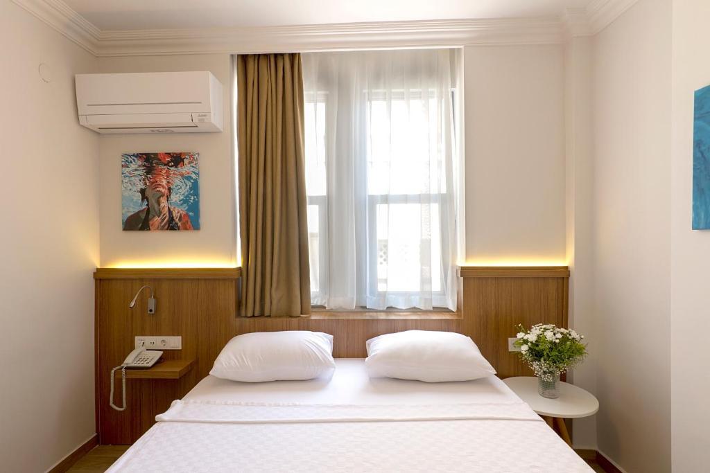 Кровать или кровати в номере Comfort Suites