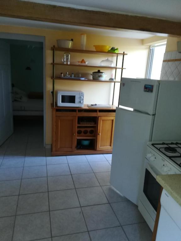 Cuisine ou kitchenette dans l'établissement L'essentiel