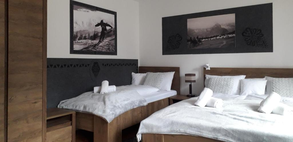A bed or beds in a room at Pokoje Gościnne KAMI