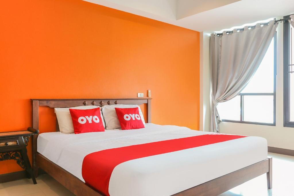 Cama ou camas em um quarto em OYO 233 Sunshine House