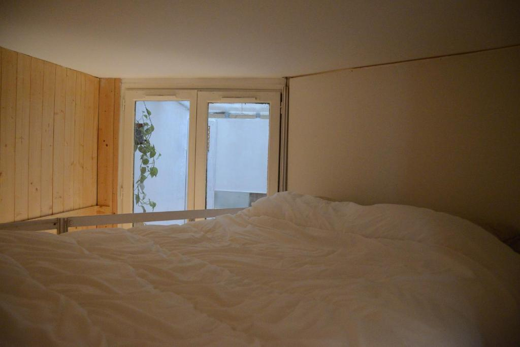 A bed or beds in a room at Apartment Sacré-Coeur