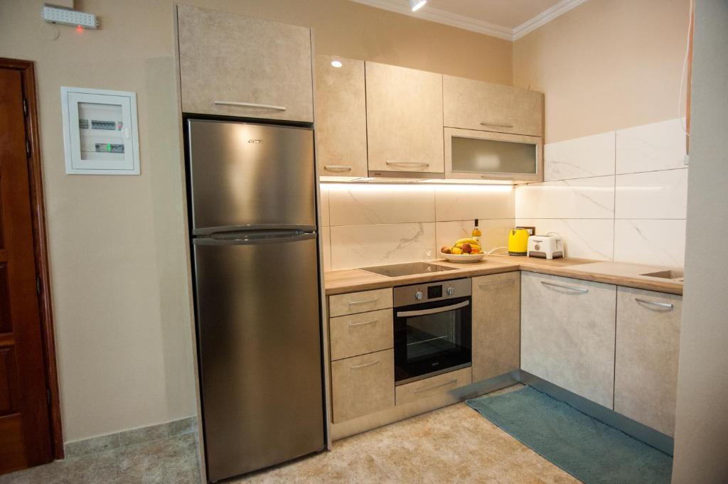 Η κουζίνα ή μικρή κουζίνα στο Monteduca Apartments