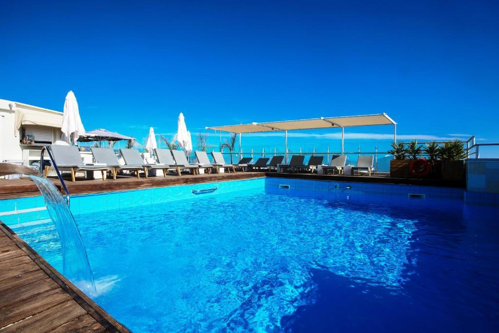 The swimming pool at or near Capsis Astoria Heraklion