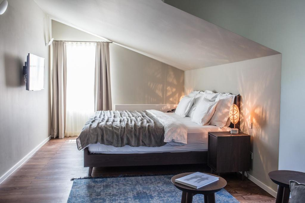 A bed or beds in a room at Boutique Hotel Boškinac