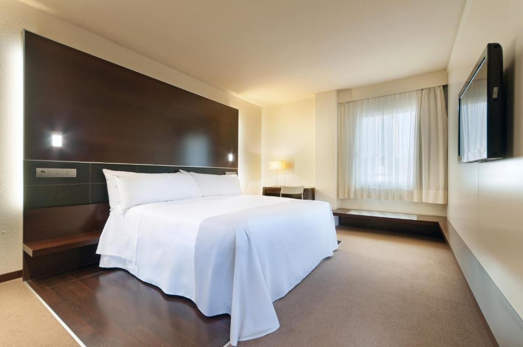 Cama o camas de una habitación en Hotel Ceuta Puerta de Africa