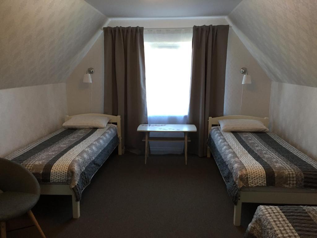 Voodi või voodid majutusasutuse Tiigi Accommodation toas