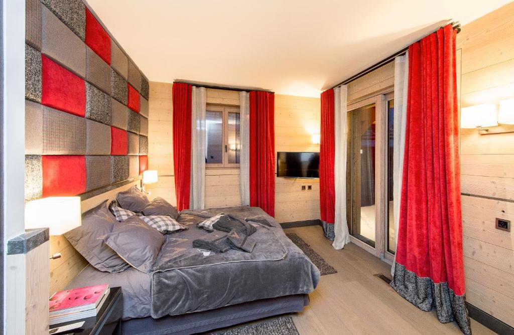 Letto o letti in una camera di Chalet Migui Luxury Living & Spa *****, Crans Montana