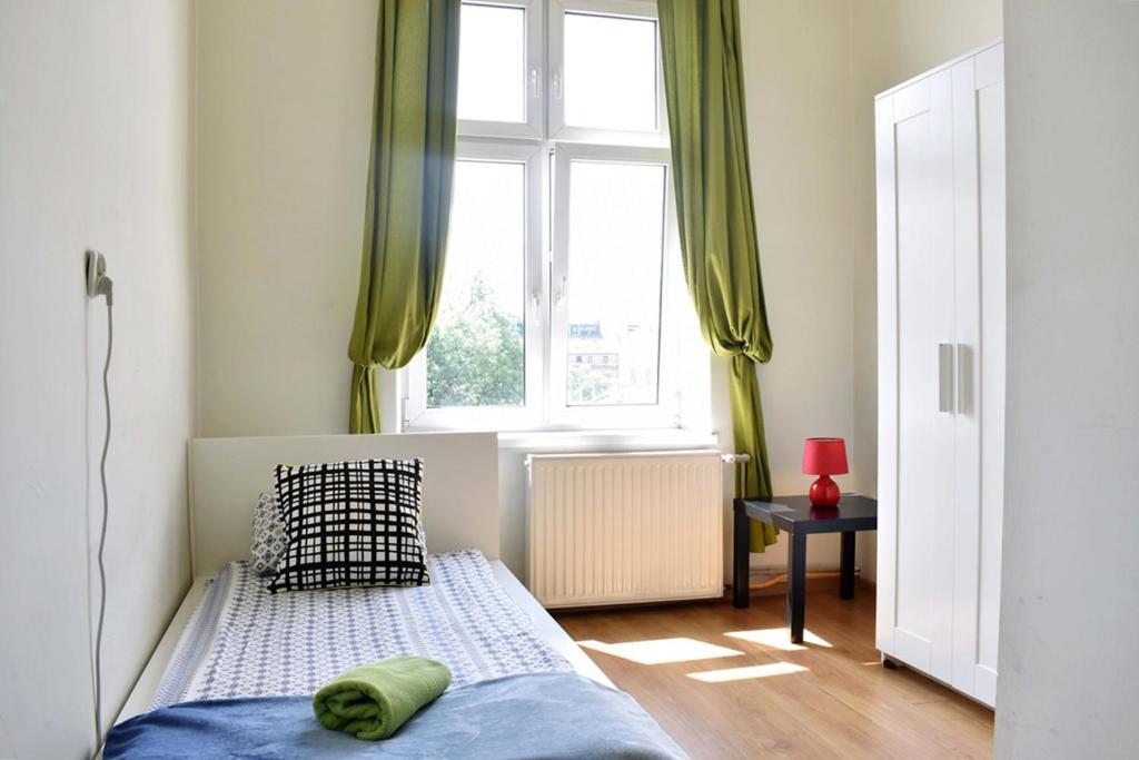 Posteľ alebo postele v izbe v ubytovaní Good Bye Lenin Revolution