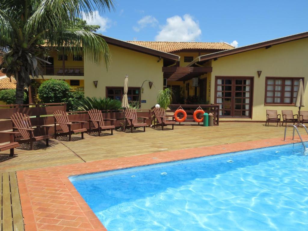 The swimming pool at or near Pousada Céu de Estrelas