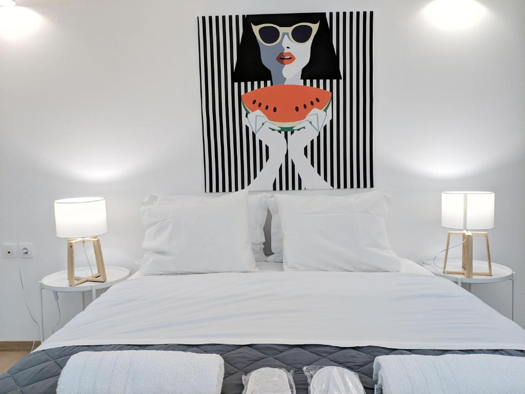 A bed or beds in a room at Vivo Apartments