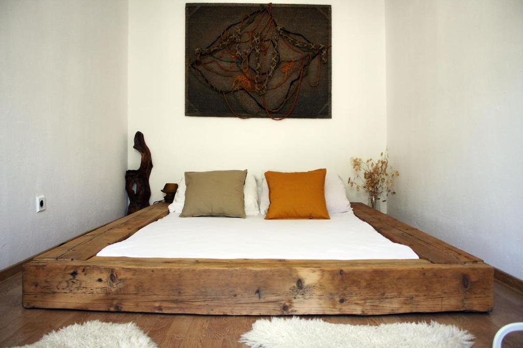A bed or beds in a room at A Charming Space