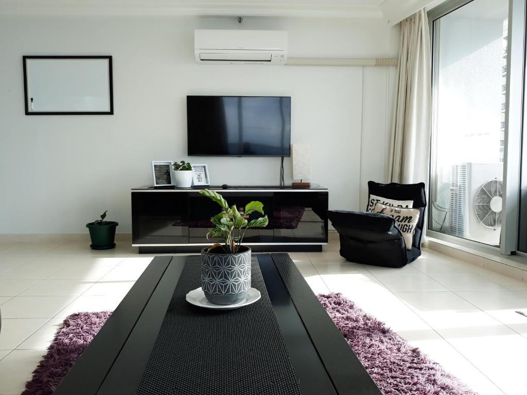 A television and/or entertainment center at Excluza - By the Sea